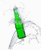 Beer bottle with water splashing out of bottle Stock Photos