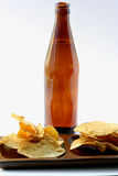 Beer Bottle With Unhealthy Eating Royalty Free Stock Photography