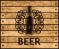 Beer bottle on wooden box Royalty Free Stock Photography