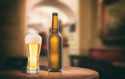 Beer bottle on a wooden table, abstract bar background. 3d illustration Stock Photos