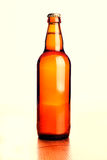 Beer bottle on a wooden table. On a white background Stock Photo