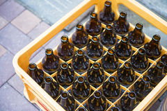 Beer bottle in yellow plastic crates Stock Photo
