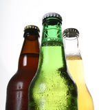 Beer bottles. 3 different coloured bottles of beer royalty free stock photos