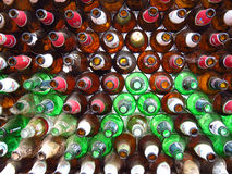 Beer Bottles BAckground. A background of beer bottles with their open side facing the camera Stock Photo