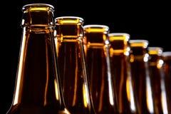 Beer bottles on black background Stock Images