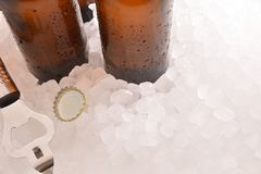 Beer bottles with bottle and cap on crushed ice stock photo