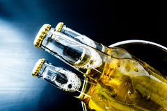 Beer in bottles with bubbles closeup Royalty Free Stock Photos