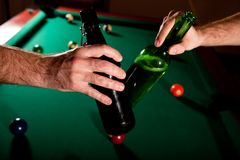 Beer bottles clinked at snooker Royalty Free Stock Photo