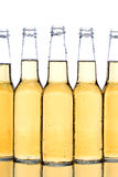 Beer bottles closeup. With reflection isolated on white Royalty Free Stock Photography