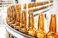 Beer bottles on the conveyor belt Stock Photo
