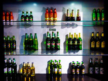 The beer bottles from different countries stock photos