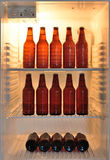 Beer bottles in a fridge Royalty Free Stock Photography