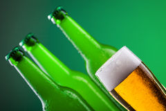 Beer bottles with full glass Stock Images