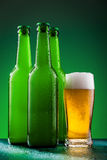 Beer bottles with full glass Royalty Free Stock Photography