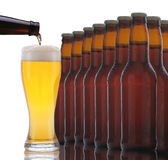 Beer Bottles With Glass Being Poured Royalty Free Stock Images