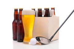 Beer Bottles with Golf Club and Ball Royalty Free Stock Image