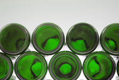 Beer bottles of green glass background Stock Photos