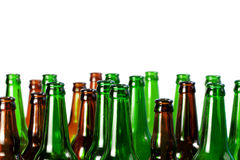 Beer bottles of green glass and a brown Royalty Free Stock Photo
