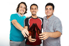 Beer bottles in guys hands Royalty Free Stock Images