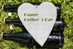 Beer bottles with heart, happy father´s day. Love stock image