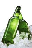 Beer Bottles On Ice Cubes Royalty Free Stock Image