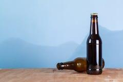 Beer bottles over blue Stock Photos