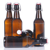 Beer bottles standing and lying isolated Stock Photo