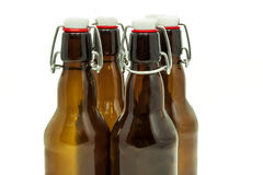 Beer bottles. With stoppers on white Stock Photos