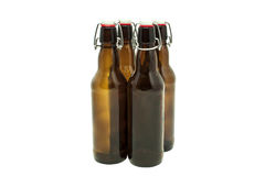 Beer bottles. With stoppers on white Royalty Free Stock Image