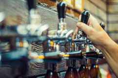 Beer bottles. Valves for filling beer bottles Royalty Free Stock Photos