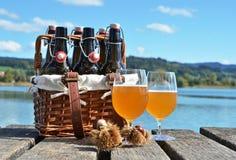 Beer bottles in the vintage basket Stock Photo
