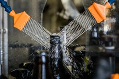 Beer bottles washing on factory Royalty Free Stock Image