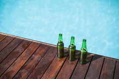 Beer bottles on wooden panel Stock Photography