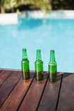 Beer bottles on wooden panel Royalty Free Stock Photo