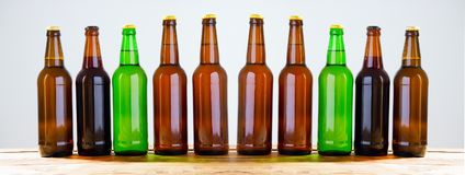 Beer bottles on a wooden table . Top view. Selective focus. Mock up. Copy space.Template. Blank. Beer bottles on a wooden table . Top view. Selective focus stock photography
