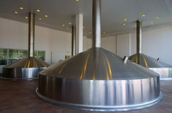 Beer-brewing tanks in industrial building stock photos