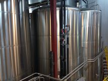 Beer brewing fermentation tanks. Fermenting vats at a craft beer microbrewery Royalty Free Stock Image