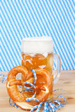 Beer with brezel and paper streamers Stock Photos