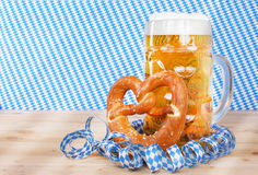 Beer with brezel and paper streamers Royalty Free Stock Photos