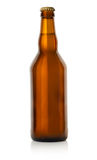 Beer in a brown bottle Stock Images