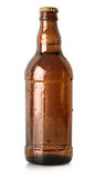 Beer in a brown bottle isolated Royalty Free Stock Photography