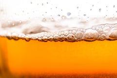 Beer bubbles. Golden brown beer bubbles with macro Stock Image