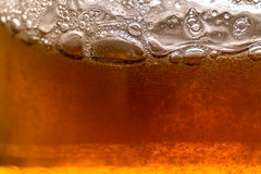 Beer bubbles. Golden brown beer bubbles with macro Stock Photography