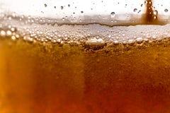 Beer bubbles. Golden brown beer bubbles with macro Stock Photo