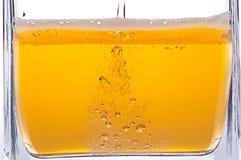 Beer bubbles. Pouring beer into a mug Stock Photos