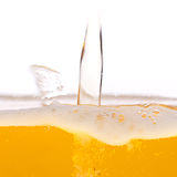 Beer bubbles. Pouring beer into a mug Royalty Free Stock Photos