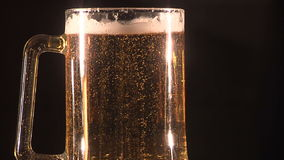 Beer. Bubbles rising in a glass. Medium shot stock footage