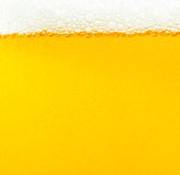 Beer bubbles. The yellow background - the detail of beer Royalty Free Stock Photo