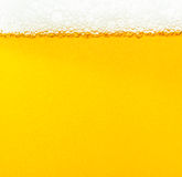 Beer bubbles. The yellow background - the detail of beer Stock Image