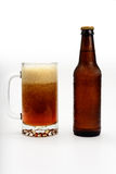 Beer Bubbling in Mug and Bottle Royalty Free Stock Image